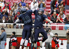 Juan Diego's Cayden Sanchez, left, and Konner Kfentzis celebrate after Kfentzis made an interception during the 3A high school football championships Friday, Nov. 19, 2010, in Salt Lake City. Juan Diego defeated Hurricane for the 3A title 10-7. (Jim Urquhart/ Special to The Salt Lake Tribune)