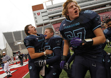 Juan Diego teammates, from left, Nathan Elorreaga, Anthony Barbiero and Harrison Jones celebrate at the end of the 3A high school football championships Friday, Nov. 19, 2010, in Salt Lake City. Juan Diego defeated Hurricane for the 3A title 10-7. (Jim Urquhart/ Special to The Salt Lake Tribune)