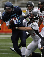 Juan Diego's Oliver Weight is tackled by Hurricane's Josh Bullock during the 3A high school football championships Friday, Nov. 19, 2010, in Salt Lake City. Juan Diego defeated Hurricane for the 3A title 10-7. (Jim Urquhart/ Special to The Salt Lake Tribune)