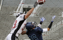 Hurricane's Jarom Healey, left, defends on a pass to Juan Diego's Oliver Weight during the 3A high school football championships Friday, Nov. 19, 2010, in Salt Lake City. Juan Diego defeated Hurricane for the 3A title 10-7. (Jim Urquhart/ Special to The Salt Lake Tribune)