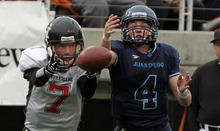 Hurricane's Taylor Parker, left, and Juan Diego's Nathan Elorreaga battle for a pass during the 3A high school football championships Friday, Nov. 19, 2010, in Salt Lake City. Juan Diego defeated Hurricane for the 3A title 10-7. (Jim Urquhart/ Special to The Salt Lake Tribune)