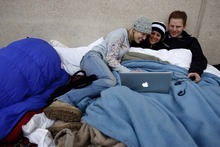 Trent Nelson  |  The Salt Lake Tribune Stephanie Gammell, Erin Appelbaum and Tyson England spent the night in line outside of the Sandy Costco to have a book signed by former President George W. Bush on Friday. By 7 a.m., the line reached most of the way around the building.