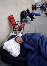 Trent Nelson  |  The Salt Lake Tribune Don Toomey showed up at 11:30 p.m. Thursday night with an inflatable mattress and sleeping bag, securing a place in line to have a book signed by former President George W. Bush at the Costco in Sandy on Friday.