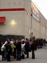 Trent Nelson  |  The Salt Lake Tribune Hundreds of people were in line at dawn at the Costco in Sandy on Friday, Nov. 19, 2010, waiting to have a book signed by former President George W. Bush. By 7 a.m., the line reached most of the way around the building.