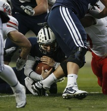 Trent Nelson  |  The Salt Lake Tribune BYU quarterback Jake Heaps (9) dives for a touchdown during the first half,  BYU vs. New Mexico, Saturday, November 20, 2010.