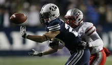 Trent Nelson  |  The Salt Lake Tribune BYU receiver Luke Ashworth (29) bobbles the ball, during the second half,  BYU vs. New Mexico, Saturday, November 20, 2010. The pass was ruled incomplete. Defending is New Mexico's DeShawn Mills.