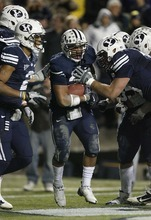 Trent Nelson  |  The Salt Lake Tribune BYU running back Joshua Quezada (20) celebrates his second half touchdown,  BYU vs. New Mexico, Saturday, November 20, 2010.