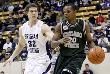 BYU guard Jimmer Fredette (32) guards Chicago State guard Christian Wall (20) during the first half of their NCAA  college basketball game Saturday, Nov. 20, 2010, in Provo, Utah. (AP Photo/Jim Urquhart)