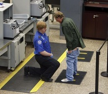 Trent Nelson     The Salt Lake Tribune A visibly frustrated traveler pulled down his pants during a pat down by a TSA agent at a security checkpoint in the Salt Lake International Airport, Tuesday, November 23, 2010.
