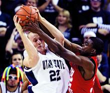Rick Egan  |  The Salt Lake Tribune Utah State University's Brady Jardine battles Utah's Shawn Glover for a rebound during a game in Logan on Nov. 22.