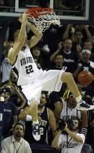 Rick Egan   |  The Salt Lake Tribune  Utah State University's Brady Jardine (22) gets a slam dunk, in basketball action,University of Utah vs. The Utah State Aggies in Logan,  Monday, November 22, 2010.