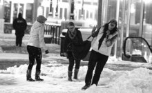 Leah Hogsten  |  The Salt Lake Tribune l-r Amanda Heller, Molly Menzie and Christine Chachas play in the snow at Gateway after seeing a movie.   A blizzard blew into Salt Lake County just after 5 p.m. Tuesday and was expected to last several hours, according to the National Weather Service. At 6 p.m., the National Weather Service reported that the blizzard should dump snow for up to four hours. Poor visibility, strong winds, blowing snow and dangerous driving conditions were also present throughout northern Utah. Tuesday, November 23, 2010, in SLC.