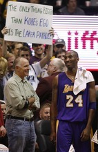 Trent Nelson  |  The Salt Lake Tribune Los Angeles Lakers guard Kobe Bryant (24) smiles after sharing words with a fan holding a sign referencing Bryant's ego. Utah Jazz vs. Los Angeles Lakers, NBA basketball Friday, November 26, 2010 at EnergySolutions Arena.