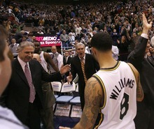 Trent Nelson  |  The Salt Lake Tribune Utah Jazz guard Deron Williams (8) walks off the court following the Jazz victory. Jazz coaches Phil Johnson (left) and Jerry Sloan at rear. Utah Jazz vs. Los Angeles Lakers, NBA basketball Friday, November 26, 2010 at EnergySolutions Arena.