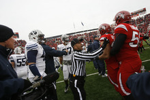 Chris Detrick  |  The Salt Lake Tribune  A referee breaks up a fight between Utah and BYU players before kick off as the Utes face BYU at Rice-Eccles Stadium Saturday, November 27, 2010.