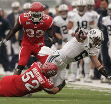 Trent Nelson  |  The Salt Lake Tribune  BYU receiver McKay Jacobson (6) is tackled by Utah Utes linebacker Matt Martinez (52) as the Utes face BYU in the first quarter at Rice-Eccles Stadium Saturday, November 27, 2010.