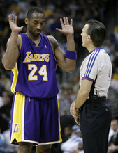 Los Angeles Lakers guard Kobe Bryant, left, talks to referee Ken Mauer after Bryant was called for his third personal foul, in the third quarter of the Denver Nuggets' 113-86 victory in an NBA basketball game in Denver on Thursday, March 15, 2007. (AP Photo/David Zalubowski)nba trade demandsnba trade demands