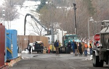 Rick Egan   |  The Salt Lake Tribune  Cleanup crews work Friday at the site where oil spilled near Red Butte Garden in Salt Lake City. Chevron estimates that up to 500 barrels of crude were spilled.