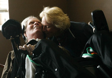 Leah Hogsten  |  The Salt Lake Tribune Brooke Hopkins shares a tender moment with his wife, Peggy Battin, before departing South Davis Community Hospital for the comforts of their Avenues neighborhood home. Hopkins was supposed to leave the facility in August, but hurdles such as pneumonia, falling blood pressure, a vacillating temperature and a problem with his diaphragmatic pacer resulted in several delays.
