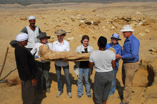 Removing mummy during 2010 BYU Egypt Excavation at Fag el Gamous Cemetery, Fayum, Egypt. BYU students (from left to right) Courtney Innes, Audrey Crandell, Aubrey E. Brower, Kim Matheson; BYU Professor C. Wilfred Griggs; local Egyptian workers.