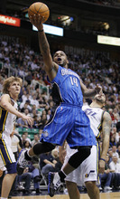 Orlando Magic guard Jameer Nelson (14) attempts to score as Utah Jazz small forward Andrei Kirilenko, left, of Russia, and guard Deron Williams, right, defend during the first half of an NBA basketball game in Salt Lake City, Friday, Dec. 10, 2010. (AP Photo/Colin E Braley)