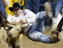 Dean Gorsuch competes in the steer wrestling competition during the ninth go-round of National Finals Rodeo Friday, Dec. 10, 2010, in Las Vegas. Gorsuch tied for first place for the night. (AP Photo/Isaac Brekken)