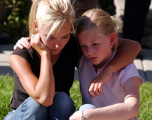 Danny Chan La  |  The Salt Lake Tribune  Elizabeth Smart's cousins Amanda Smart (left)  and Tori Dumke console each other after a news conference where Edward Smart, the missing girl's father, spoke to reporters.