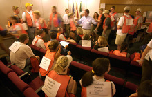Steve Griffin  |  The Salt Lake Tribune  Volunteers are briefed in the auditorium of Shriner's Hospital in Salt Lake City prior to departing on their search assignments June 7, 2002. Hundreds of volunteers again showed up to due what ever they could in search efforts for Elizabeth Smart, who was kidnapped from her home June 5, 2002.