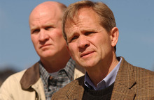 Francisco Kjolseth  |  The Salt Lake Tribune  Ed Smart, front, alongside his brother, Tom, speaks to the media in February, 2003, about the search for