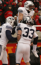 Trent Nelson  |  The Salt Lake Tribune  BYU receiver McKay Jacobson (6) celebrates his touchdown with BYU running back Bryan Kariya (33) and BYU running back Mike Hague (32) as the Utes face BYU in the third quarter at Rice-Eccles Stadium Saturday, November 27, 2010.