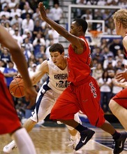 Djamila Grossman  |  The Salt Lake Tribune  Brigham Young University's Jimmer Fredette, 32, is blocked by the University of Arizona's Kyle Fogg, 21, during a game in Salt Lake City, on Saturday, Dec. 11, 2010. BYU won the game.
