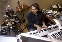 Al Hartmann  |  The Salt Lake Tribune  Utah composer Kurt Bestor prepares for his 22nd annual Christmas concert series at his home studio.  He uses modern technology to compose his music and connect with his band members and audiences.  He often composes with one hand on a music keyboard and the other on a computer keyboard.