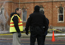 Rick Egan   |  The Salt Lake Tribune  Provo Mayor John Curtiss (yellow vest) talks to Provo policemen in front of the Provo Tabernacle, Friday, December 17, 2010.
