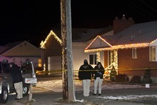 Chris Detrick  |  The Salt Lake Tribune  Roy police investigate the scene of a fatal shooting near 1900 West and 4400 South on Thursday, Dec. 16, 2010.   A second person was also injured in the shooting that was reported at 6:30 p.m., a Weber County dispatcher said.