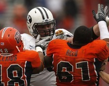 Trent Nelson  |  The Salt Lake Tribune BYU offensive lineman Braden Hansen (76) gets in a minor tussle with UTEP's Aubrey Alexius (48) and UTEP's Germard Reed (61) as BYU defeats UTEP in the New Mexico Bowl, college football Saturday, December 18, 2010 in Albuquerque, New Mexico.