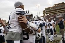 Trent Nelson  |  The Salt Lake Tribune BYU quarterback Jake Heaps (9) embraces BYU defensive back Brian Logan (7) in the final minutes as BYU defeats UTEP in the New Mexico Bowl, college football Saturday, December 18, 2010 in Albuquerque, New Mexico.