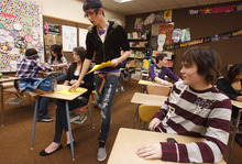Leah Hogsten  |  The Salt Lake Tribune Above, senior Stetson Sheffield (right) hands out questionnaires at a meeting of the Clearfield High Gay-Straight Alliance on Dec. 9, 2010.