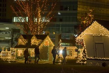 Paul Fraughton  |  The Salt Lake Tribune   Visitors make their way through the lavishly decorated grounds of Ogden's Christmas Village on  Monday,December 20, 2010