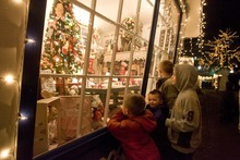 Paul Fraughton  |  The Salt Lake Tribune   Zack Cardon (6) with his brothers Jace (4), Trevor (10) and Lance (7)wander through Ogden's Christmas Village  looking through the windows of the  decorated small cottages  on  Monday,December 20, 2010