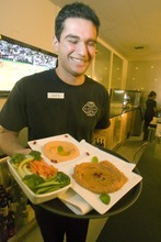Paul Fraughton  |  The Salt Lake Tribune    Safa Riadh  brings out an order of red pepper hummus and muhammara walnut spread at Layla Mediterranean Grill and Mezze in Holladay. The Tadros family has transformed their former Confetti's restaurant in name and menu to a gorgeously decorated and sumptuously flavored Mediterranean restaurant.