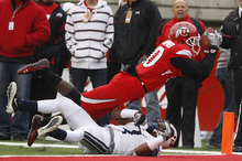 Chris Detrick  |  The Salt Lake Tribune  Utah Utes wide receiver DeVonte Christopher #10 catches a pass for a touchdown under pressure from BYU defensive back Brian Logan (7) as the Utes face BYU in the third quarter at Rice-Eccles Stadium Saturday, November 27, 2010.