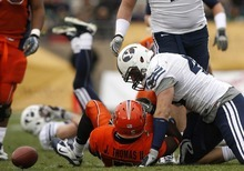 Trent Nelson  |  The Salt Lake Tribune BYU linebacker Jadon Wagner (49) brings down UTEP's James Thomas II in the first half as BYU faces UTEP in the New Mexico Bowl, college football Saturday, December 18, 2010 in Albuquerque, New Mexico.