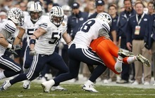 Trent Nelson  |  The Salt Lake Tribune BYU linebacker Jameson Frazier (48) picks up UTEP's Marlon McClure and throws him to the ground in the first half as BYU faces UTEP in the New Mexico Bowl, college football Saturday, December 18, 2010 in Albuquerque, New Mexico.