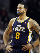 Utah Jazz guard Deron Williams stands at half court late in the fourth quarter of the 100-89 loss  in their NBA basketball game against the Portland Trail Blazers in Portland, Ore., Thursday, Dec.30, 2010.  Williams led the Jazz inscoring with 19 points.(AP Photo/Don Ryan)