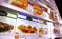 ** ADVANCE FOR USE MONDAY, DEC. 27, 2010 AT 12:01 A.M. AND THEREAFTER ** In this Dec. 14, 2010 photo, products made by American Halal Co., Inc., bottom row, join other frozen food products in a freezer case at a Whole Foods store in Darien, Conn. The company helped Whole Foods develop its first nationally distributed halal (Islamically permitted) food product called Saffron Road entrees that the food stores started selling in August. (AP Photo/Craig Ruttle)