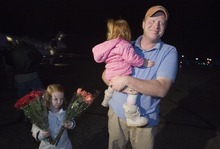 Jim Urquhart  |  The Salt Lake Tribune Jeremy Johnson, with daughters Allie, left, and Bree, returns to St. George Jan. 26, 2010. Johnson, who spent two weeks in Haiti helping earthquake victims, is accused in a federal lawsuit of taking in $275 million since 2006 in a