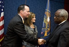 Djamila Grossman  |  The Salt Lake Tribune  Sen. Mike Lee, R-Utah, and his wife, Sharon, talk to Supreme Court Justice Clarence Thomas during a gathering with friends, family, and other public officials after Lee was sworn in as a senator on Capitol Hill in Washington, D.C., Wednesday, Jan. 5, 2011.