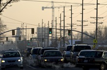 Djamila Grossman  |  The Salt Lake Tribune  View of cars in traffic in Provo, with the fog of the inversion in the background, Friday, Jan. 7, 2011.