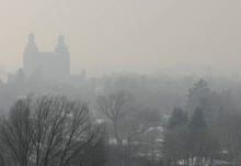 The LDS temple and city of Logan are covered in a haze Friday afternoon. (Eli Lucero/Herald Journal)