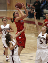 Scott Sommerdorf  l  The Salt Lake Tribune Springville's Lexi Eaton (5) takes a shot while getting lots of attention from  the Herriman defense during second half play. Springville beat Herriman 60-21, Friday 1/7/2011. #5 for Herriman is Bri Sorenson.